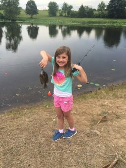 campers have fun fishing in our on-site pond